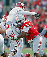 Ohio State Buckeyes defensive lineman Adolphus Washington (92) hits the Indiana Hoosiers quarterback Nate Sudfeld (7) during the second quarter of their College football game at Ohio Stadium in Columbus, Ohio on November 23, 2013.  (Dispatch photo by Kyle Robertson)