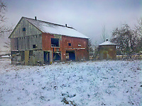 Verizon Droid photo of snow covered barn and rolls of hay on a farm.