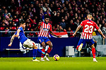 Yuri Berchiche of Athletic de Bilbao (L) competes for the ball with Thomas Teye Partey of Atletico de Madrid (C) during the La Liga 2018-19 match between Atletico de Madrid and Athletic de Bilbao at Wanda Metropolitano, on November 10 2018 in Madrid, Spain. Photo by Diego Gouto / Power Sport Images