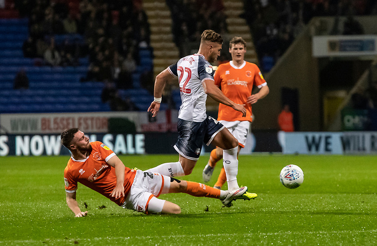 Bolton Wanderers' Dennis Politic competing with Blackpool's James Husband (left) <br /> <br /> Photographer Andrew Kearns/CameraSport<br /> <br /> The EFL Sky Bet League One - Bolton Wanderers v Blackpool - Monday 7th October 2019 - University of Bolton Stadium - Bolton<br /> <br /> World Copyright © 2019 CameraSport. All rights reserved. 43 Linden Ave. Countesthorpe. Leicester. England. LE8 5PG - Tel: +44 (0) 116 277 4147 - admin@camerasport.com - www.camerasport.com