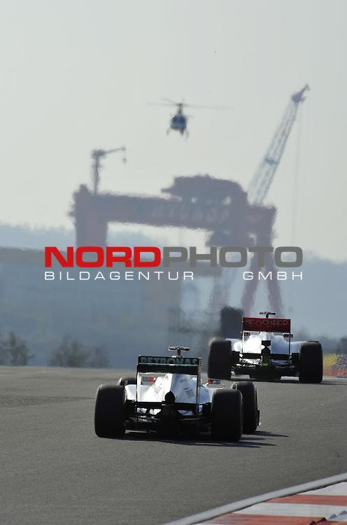 11.-14.10.2011, Korea-International-Circuit, Yeongam, KOR, F1, Gro&szlig;er Preis von S&uuml;dkorea, Yeongam, im Bild Michael Schumacher (GER), Mercedes GP - Jenson Button (GBR),  McLaren F1 Team  <br />  Foto &copy; nph / Mathis
