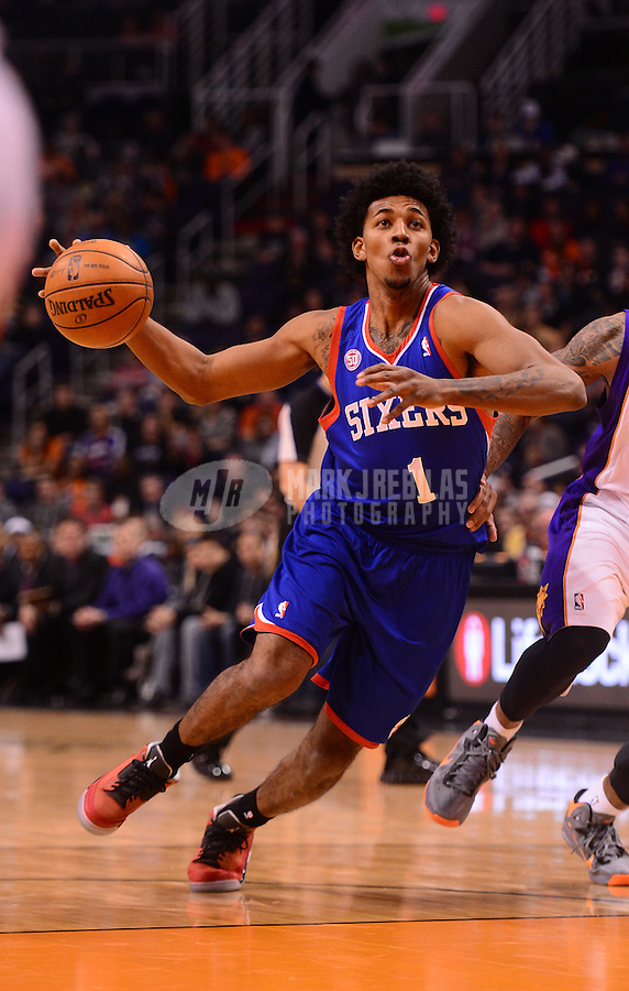 Jan. 2, 2013; Phoenix, AZ, USA: Philadelphia 76ers guard Nick Young (1) drives to the basket against the Phoenix Suns in the first half at the US Airways Center. Mandatory Credit: Mark J. Rebilas-USA TODAY Sports