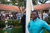 Horse owner Sidney Armstrong (L) looking on at Simanga Khumalo (R), the jockey who rode Lazrin to a win in the Kenya Derby.