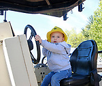 """Torrington, CT 051819MK03 Oliver frank, two and a half from Litchfield, takes the wheel of heavy equipment at the O&G Industries' annual Touch a Truck Family Fun Event at their maintenance facility on Saturday Morning.  Seth Duke, marketing director, said """" With the weather so nice today we will receive over two-thousand attendees and the suggested donations will be donated to Kids Play to help with their continued development.""""  O&G's Jim Zambero, vice president of equipment purchase and maintenance, said that sixty volunteers and twentyfive local vendors helped host the event while members of the Operational Engineer's Union Local #478 directed traffic and managed parking . Michael Kabelka / Republican-American"""
