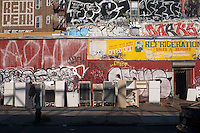 Brooklyn, NY 18 November 2009 - Used Refrigerators and Graffiti on South 5th Street in Williamsburg
