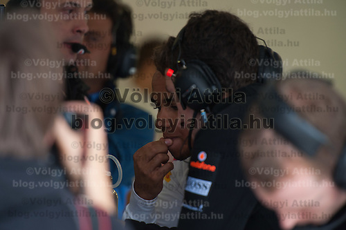 McLaren Formula One driver Lewis Hamilton of Britain checks results on a screen after the free practice during the Hungarian F1 Grand Prix in Mogyorod (about 20km north-east from Budapest), Hungary. Thursday, 28. July 2011. ATTILA VOLGYI