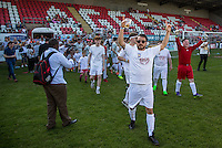 Dapper Laughs comes out with the teams carrying a beer during the 'Greatest Show on Turf' Celebrity Event - Once in a Blue Moon Events at the London Borough of Barking and Dagenham Stadium, London, England on 8 May 2016. Photo by Andy Rowland.