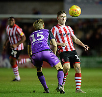 Lincoln City's Shay McCartan vies for possession with Port Vale's Nathan Smith<br /> <br /> Photographer Chris Vaughan/CameraSport<br /> <br /> The EFL Sky Bet League Two - Lincoln City v Port Vale - Tuesday 1st January 2019 - Sincil Bank - Lincoln<br /> <br /> World Copyright © 2019 CameraSport. All rights reserved. 43 Linden Ave. Countesthorpe. Leicester. England. LE8 5PG - Tel: +44 (0) 116 277 4147 - admin@camerasport.com - www.camerasport.com