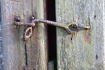 Rusty metal latch on wooden door