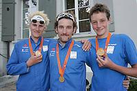 03 SEP 2006 - LAUSANNE, SWITZERLAND - British Gold medallists Will Clarke (u23), Tim Don (Elite Men) and Alistair Brownlee (Junior Men) after the World Triathlon Championships. (PHOTO (C) NIGEL FARROW)