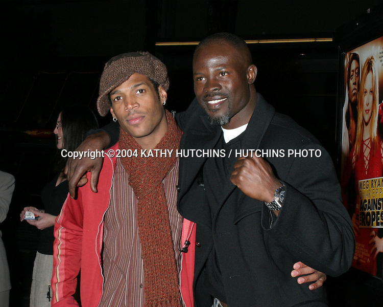 "©2004 KATHY HUTCHINS / HUTCHINS PHOTO.""AGAINST THE ROPES"" PREMIERE.HOLLYWOOD, CA.FEB 11, 2004..MARLON WAYANS.DJIMON HOUNSOU"