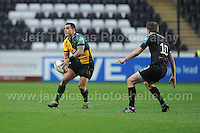 Former Ospreys scrum half Kahn Fotuali'i now with Northampton Saints throws a pass. Liberty Stadium, Swansea, South Wales 12.01.14. Ospreys v Northampton Heineken Cup round 5 pool 1 - pIc credit Jeff Thomas photography
