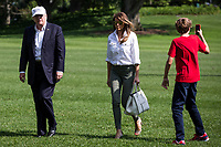 United States President Donald J. Trump, First Lady Melania Trump and their son, Barron Trump, cross the South Lawn after arriving at The White House on June 18, 2017 in Washington, D.C. President Trump spent the weekend at Camp David.<br /> Credit: Zach Gibson / Pool via CNP /MediaPunch
