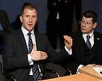 Stewart Regan explains the pyramid league structure as Neil Doncaster listens