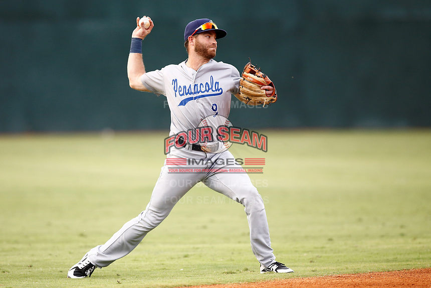 Pensacola Blue Wahoo short stop Taylor Featherston (9)throws to first base for the out during a game against the Chattanooga Lookouts on July 27, 2018 at AT&T Field in Chattanooga, Tennessee. (Andy Mitchell/Four Seam Images)