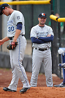 Manager Andrew Graham #17 of the West Michigan Whitecaps watches the pitcher warmup in the bullpen prior to their game against the Clinton LumberKings at Ashford University Field on July  25, 2014 in Clinton, Iowa. The Whitecaps won 9-0.   (Dennis Hubbard/Four Seam Images)