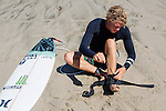 Surfer John John Florence puts on his ankle brace on the beach in Santa Monica, California September 30, 2015. <br /> CREDIT: Kendrick Brinson for The Wall Street Journal<br /> WORKOUT_florence