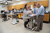 Dr. Todd Archer with students and patients in Joe Ann Ward Critical Care Unit