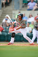 Arkansas Travelers shortstop Joey Wong (21) follows through on a swing during a game against the Frisco RoughRiders on May 28, 2017 at Dickey-Stephens Park in Little Rock, Arkansas.  Arkansas defeated Frisco 17-3.  (Mike Janes/Four Seam Images)