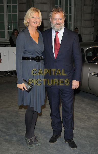 Lulu Williams & Hugh Bonneville.The 'Skyfall' Aston Martin VIP screening, Curzon Mayfair cinema, Curzon St., London, England..October 24th, 2012.full length black suit tie white red shirt dress belt blue grey gray married husband wife beard facial hair .CAP/CAN.©Can Nguyen/Capital Pictures.