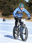 DEADWOOD, SD - JANUARY 23, 2016 -- Todd Ossenfort #12 races in the men's 40+ amateur fat-tire bike class during the 2016 Snow Jam Points Series at Tomahawk Country Club south of Deadwood, S.D. Saturday. (Photo by Richard Carlson/dakotapress.org)
