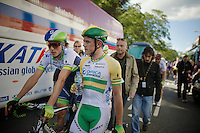 After crashing hard in the sprint, Simon Gerrans (AUS/Orica-GreenEDGE) walks back to the teambus while Jens Keukeleire (BEL/Orica-GreenEDGE) comes up to check with him.<br /> <br /> 2014 Tour de France<br /> stage 1: Leeds - Harrogate (190.5km)