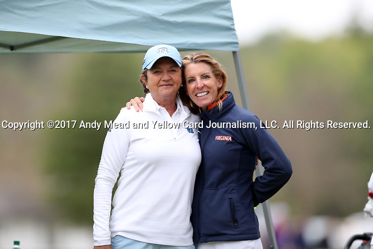 CHAPEL HILL, NC - OCTOBER 14: North Carolina head coach Jan Mann (left) with Virginia head coach Kim Lewellen (right). The second round of the Ruth's Chris Tar Heel Invitational Women's Golf Tournament was held on October 14, 2017, at the UNC Finley Golf Course in Chapel Hill, NC.
