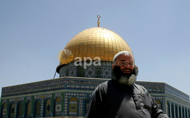 Palestinian Muslim man walks in front of the Dome of Rock after Friday prayers in the Al Aqsa Mosque compound, also known to Jews as the Temple Mount, in Jerusalem's old city on May 28, 2010. Photo by Mahfouz Abu Turk