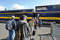 Travelers line up to board the Alaska Railroad's Denali Star train at the Denali Depot.