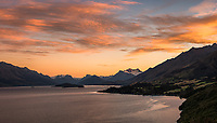 Sunrise over Lake Wakatipu with Mt. Aspiring National Park and Mt. Earnslaw in background, Glenorchy, Oueenstown, Central Otago, New Zealand, NZ