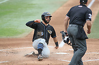 Bowie, MD - May 6, 2018: Akron RubberDucks third baseman Joe Sever (9) scores a run during the MiLB game between Akron and Bowie at  Baysox Stadium in Bowie, MD.  (Photo by Elliott Brown/Media Images International)