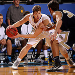BROOKINGS, SD - OCTOBER 30:  Jake Bittle #4 from South Dakota State University looks to make a move past Troy Whiteto, II #30 from South Dakota School of Mines in the first half of their exhibition game Thursday night at Frost Arena in Brookings. (Photo by Dave Eggen/Inertia)