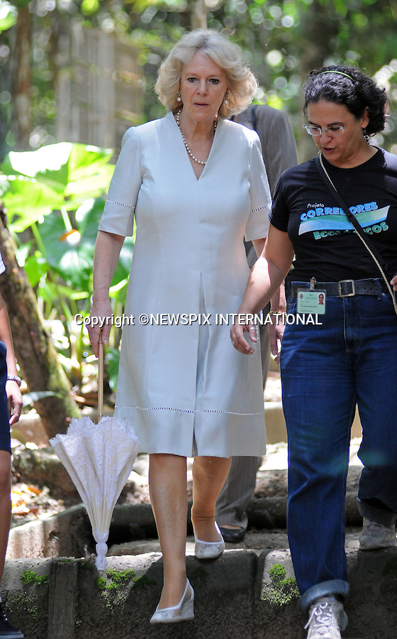 """CAMILLA, DUCHESS OF CORNWALL.Visits the National Institute for Amazon Research.Camilla toured the jungle/rainforest including the """"Science Woods"""", feed turtles in the lake and also marveled at the size of the electric eels in a pond.The Duchess was wearing an Anna Valentine silk shift dress (Pale blue with white beaded detail)..Forth day Brazil on the second leg of their South American Tour, Manaus, Brazil_14/03/09.......Mandatory Credit Photo: ©DIAS-NEWSPIX INTERNATIONAL..Please telephone : +441279324672 for usage fees..**ALL FEES PAYABLE TO: """"NEWSPIX INTERNATIONAL""""**..IMMEDIATE CONFIRMATION OF USAGE REQUIRED:.Newspix International, 31 Chinnery Hill, Bishop's Stortford, ENGLAND CM23 3PS.Tel:+441279 324672  ; Fax: +441279656877.Mobile:  07775681153.e-mail: info@newspixinternational.co.uk"""