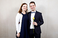Contestant Julien Sabbague of France poses with guest at a photo booth during the opening reception and dinner of the 11th USA International Harp Competition at Indiana University in Bloomington, Indiana on Wednesday, July 3, 2019. (Photo by James Brosher)