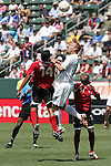 9 June 2007: United States defender Jay Demerit (12) and Trinidad and Tobago's Darryl Roberts (14) challenge for a header. The United States Men's National Team defeated the National Team of Trinidad & Tobago 2-0 at the Home Depot Center in Carson, California in a first round game in the CONCACAF Gold Cup.