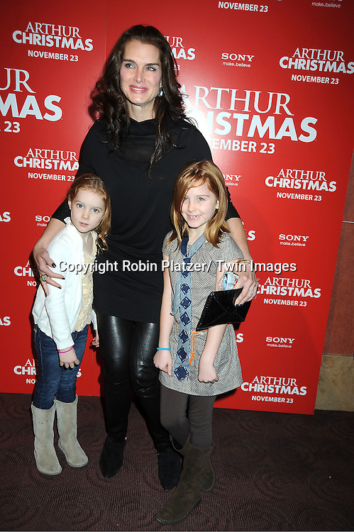 """Brooke Shields and daughters Rowan and Grier posing for photographers at The New York Special Screening of """"Arthur Christmas"""" on November 13, 2011 at The Clearview Chelsea Theatre in New York City."""