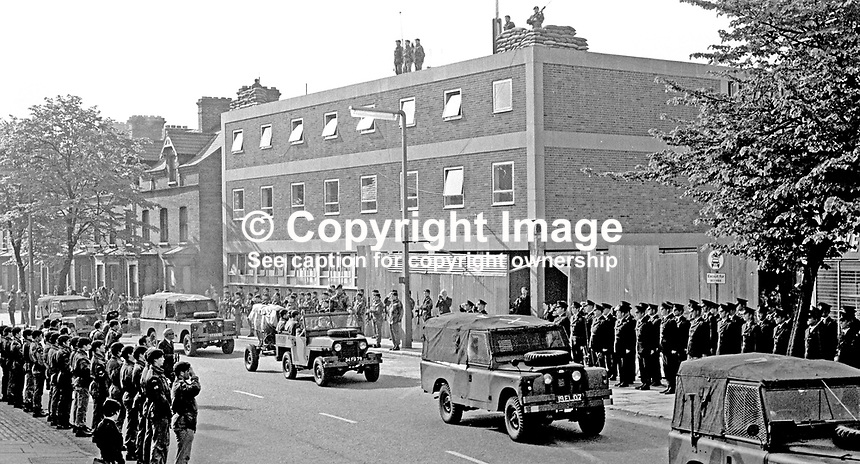 Members of the RUC and regimental colleagues line up in a guard of honour as the Union Jack draped coffin of Sergeant Michael Willets on a gun carriage passes Springfield Road Police Station. The paratrooper who died on 25th May 1971 used his body to shield 2 children from a bomb lobbed into the police station. His spontaneous act of courage earned him a postumous George Cross. 197105280208b<br /> <br /> Copyright Image from Victor Patterson,<br /> 54 Dorchester Park, <br /> Belfast, UK, BT9 6RJ<br /> <br /> t1: +44 28 9066 1296 (from Rep of Ireland 048 9066 1296)<br /> t2: +44 28 9002 2446 (from Rep of Ireland 048 9002 2446)<br /> <br /> m: +44 7802 353836<br /> <br /> e: victorpatterson@me.com<br /> www.victorpatterson.com<br /> <br /> Please see my Terms and Conditions of Use at www.victorpatterson.com. It is IMPORTANT that you familiarise yourself with them.<br /> <br /> Images used on the Internet must be visibly watermarked i.e. &copy; Victor Patterson<br /> within the body of the image and copyright metadata must not be deleted. Images <br /> used on the Internet have a size restriction of 4kbs and will be chargeable at current<br />  NUJ rates unless agreed otherwise.<br /> <br /> This image is only available for the use of the download recipient i.e. television station, newspaper, magazine, book publisher, etc, and must not be passed on to any third <br /> party. It is also downloaded on condition that each and every usage is notified within 7 days to victorpatterson@me.com<br /> <br /> The right of Victor Patterson to be identified as the author is asserted in accordance with The Copyright Designs And Patents Act (1988). All moral rights are asserted.