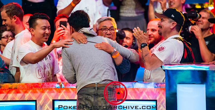 John Cynn gets a hug from dad
