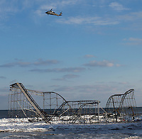 A roller coaster sitting next to the ocean, when the boardwalk it was built upon collapsed during Hurricane Sandy, in Seaside Heights, New Jersey, November 28, 2012.