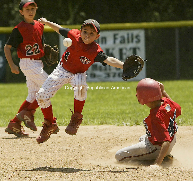 BEACON FALLS, CT 10 July 2005 -071005BZ02- As Cheshire #22, Parker Barnell looks on, left, Cheshire #4, Jason Schaff, center, jumps for the ball as Wolcott #40, Michael Bozzuto, slides safely into second <br /> during the championship game of the Willie Mays Baseball Tournament in Beacon Falls Sunday. <br /> Jamison C. Bazinet Photo