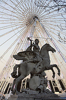 """La renommée montée sur Pegase"", marble, 1668-1702, equestrian statue by Antoine Coysevox, Lyon 1640 - Paris 1720, placed at the Tuileries in 1719, exposed at Louvre Museum, great wheel of La Concorde in the background, Paris, France Picture by Manuel Cohen"