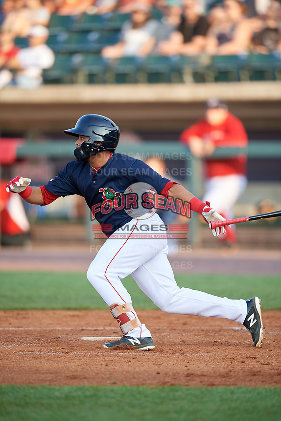 Lowell Spinners third baseman Jonathan Ortega (29) follows through on a swing during a game against the Vermont Lake Monsters on August 25, 2018 at Edward A. LeLacheur Park in Lowell, Massachusetts.  Vermont defeated Lowell 4-3.  (Mike Janes/Four Seam Images)