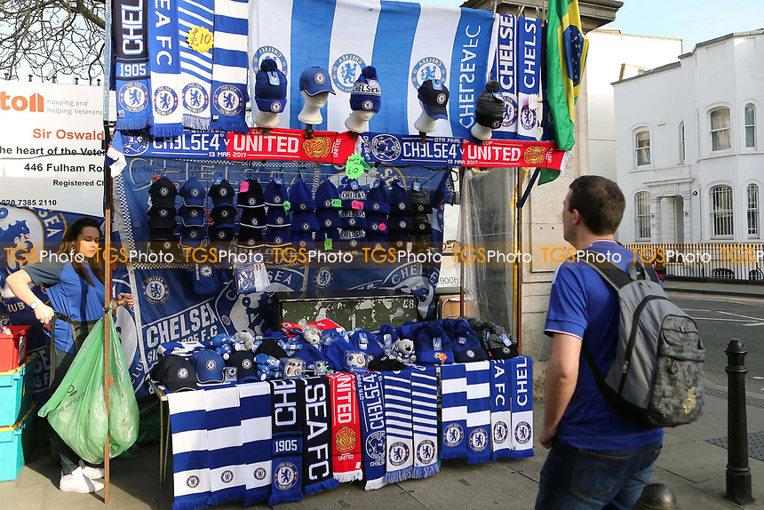 Chelsea v Manchester United scarves already on sale outside the ground on the market stalls four hours before kick-off during Chelsea vs Manchester United, Emirates FA Cup Football at Stamford Bridge on 13th March 2017