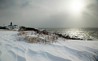 Beavertail Lighthouse on Jamestown, covered in fresh snow.