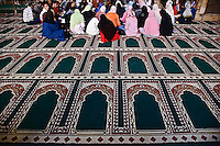 Islamic group on prayer rugs at Islamic mosque, Cairo, Egypt