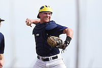 Michigan Wolverines catcher Cole Martin #46 throws to first during a game against the Seton Hall Pirates at the Big Ten/Big East Challenge at Al Lang Stadium on February 18, 2012 in St. Petersburg, Florida.  (Mike Janes/Four Seam Images)