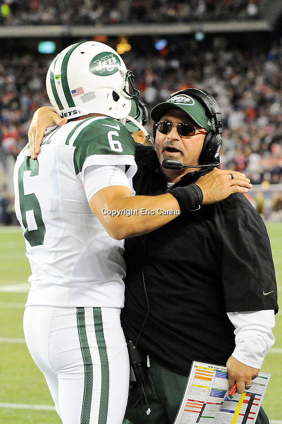 October 21, 2012 New York Jets offensive coordinator Tony Sparano congratulates quarterback Mark Sanchez (6) on a successful drive to the endzone  during the New England Patriots vs New York Jets game played at Gillette Stadium in Foxborough, Massachusetts.   Eric Canha/CSM