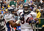 Denver Broncos wide receiver Rod Smith (80) congratulates tight end Shannon Sharpe (84) on Sunday, November 30, 2003, in Oakland, California. The Broncos defeated the Raiders 22-8.