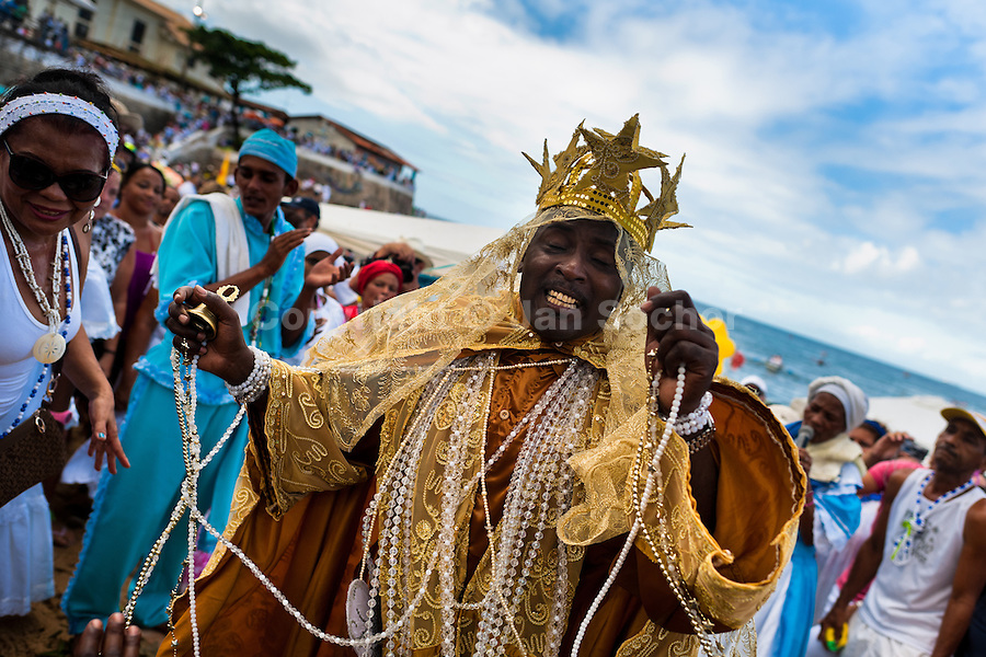 A Candomblé priest (babalorishá) dances during the ritual ceremony in honor to Yemanjá, the goddess of the sea, in Salvador, Bahia, Brazil, 2 February 2012. Yemanjá, originally from the ancient Yoruba mythology, is one of the most popular ?orixás?, the deities from the Afro-Brazilian religion of Candomblé. Every year on February 2nd, thousands of Yemanjá devotees participate in a colorful celebration in her honor. Faithful, usually dressed in the traditional white, gather on the beach at dawn to leave offerings for their goddess. Gifts for Yemanjá include flowers, perfumes or jewelry. Dancing in the circle and singing ancestral Yoruba prayers, sometimes the followers enter into a trance and become possessed by the spirits. Although Yemanjá is widely worshipped throughout Latin America, including south of Brazil, Uruguay, Cuba or Haiti, the most popular cult is maintained in Bahia, Brazil.