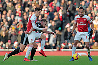 Burnley's Charlie Taylor battles with Arsenal's Mesut Ozil<br /> <br /> Photographer David Shipman/CameraSport<br /> <br /> The Premier League - Arsenal v Burnley - Saturday 22nd December 2018 - The Emirates - London<br /> <br /> World Copyright © 2018 CameraSport. All rights reserved. 43 Linden Ave. Countesthorpe. Leicester. England. LE8 5PG - Tel: +44 (0) 116 277 4147 - admin@camerasport.com - www.camerasport.com
